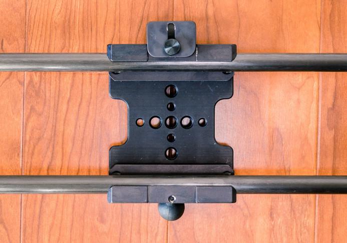 Brake fixed to center of slider