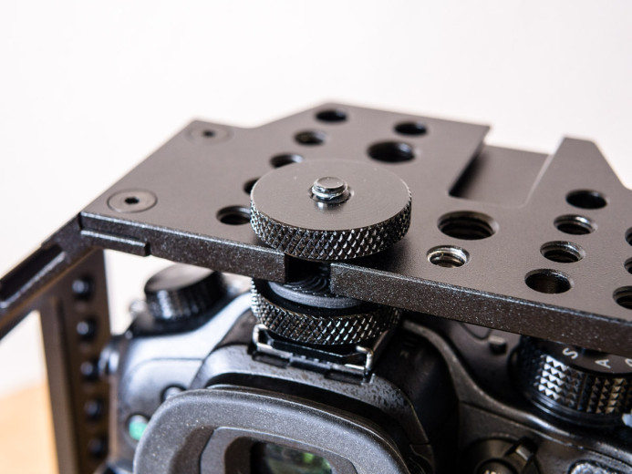 Cage attaches to GH4's hot shoe