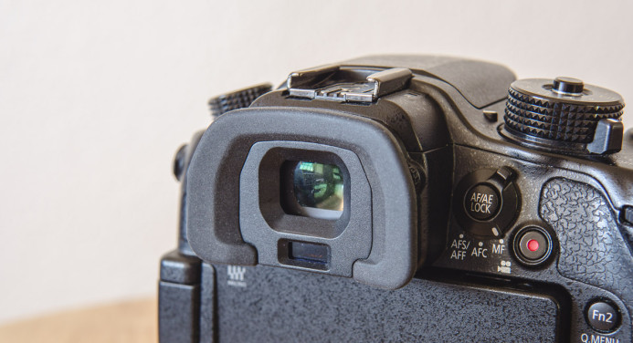 The GH4's EVF has a rubber bumper, not an eyecup
