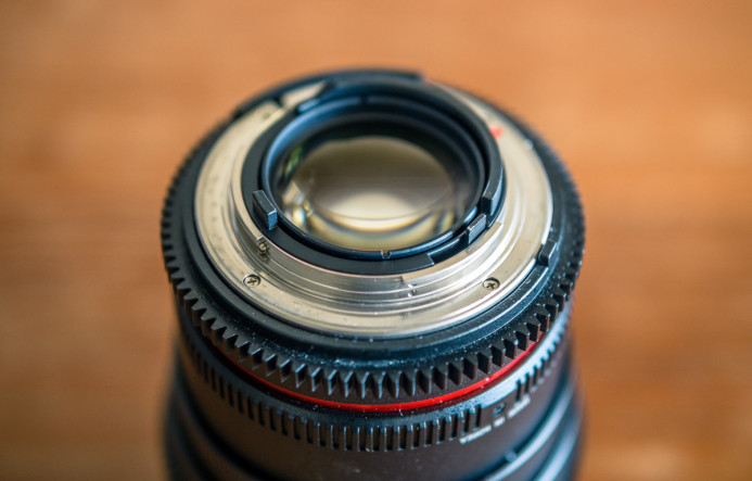 Nikon lenses use a mechanical lever to adjust aperture