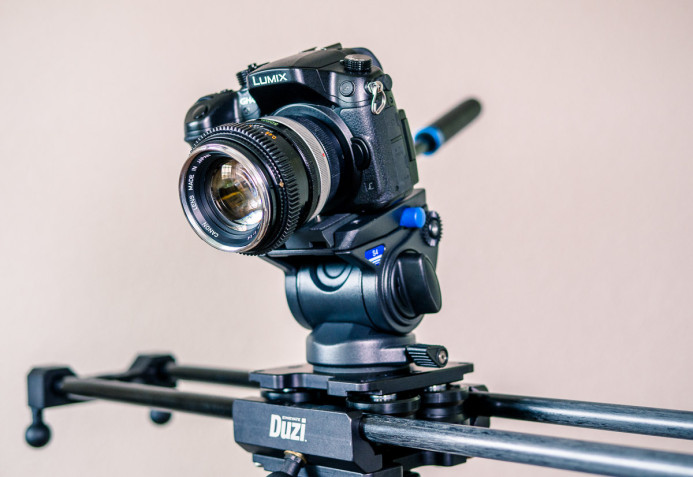 Tripod head mounted on slider carriage